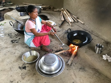 One of the women workers frying fish.