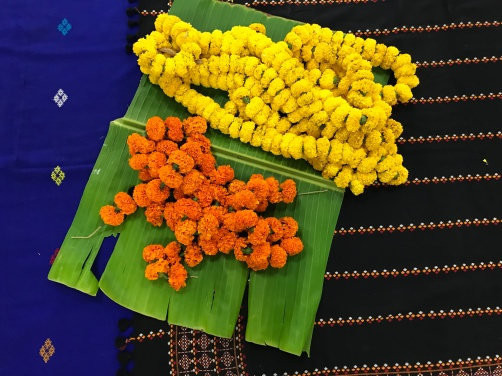 Beautiful fabric, banana leaves and flowers