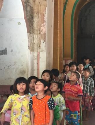 Observing the mural painting at Kyauktawgyi Pagoda